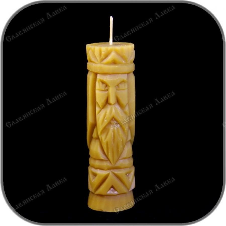 Восковая свеча с ликом бога Рода